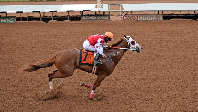 The Marfa Lights, a $145,000 Ruidoso Select Sale purchase, raced the 440 yards in :21.510.