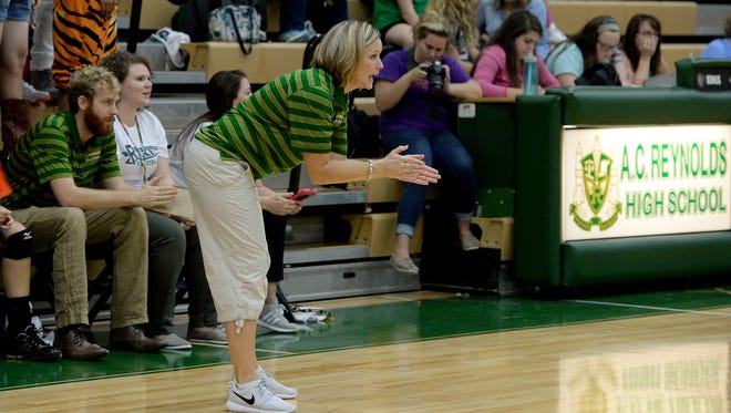 Lori Ledford has won more than 100 career matches with the Reynolds volleyball program.