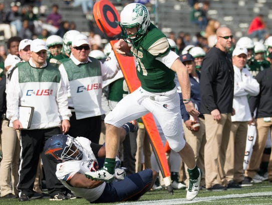 UAB Blazers quarterback A.J. Erdely carries the ball