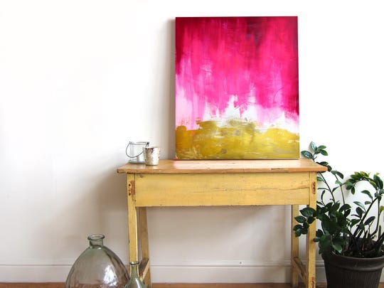 "A display featuring ""Pink and Gold Abstract"" by Christine Lindstrom"