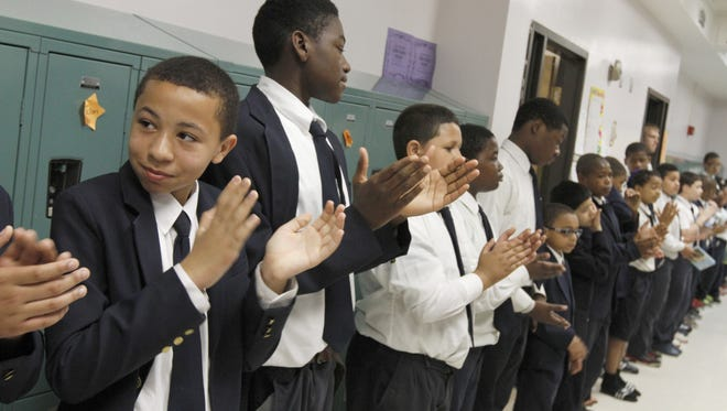 Students applaud their efforts after a successful morning of testing at the Boys Academy in School 9 back in 2013