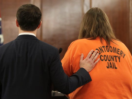 Clarksville attorney Chris Clark places his hand on
