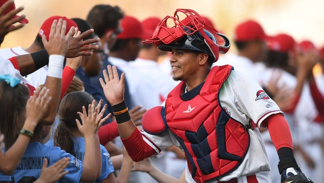 Greenville Drive catcher Isaias Lucena high fives his teammates during the Drive's opening night on Thursday, April 12, 2018 at Fluor Field at The West End.