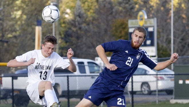 Notre Dame's Andrew Finnerty heads the ball alongside Graydon Vick of Chenango Forks on Wednesday during a Section 4 Class B boys soccer semifinal at Notre Dame.