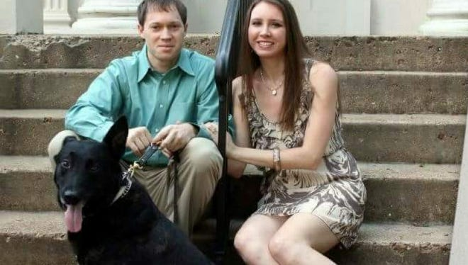 Brandon and Kristen King sit with their dog, Bono, who got trapped inside a burning house Jan. 3 but survived.