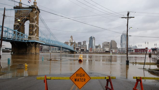 The Ohio River overflows its banks along the Covington waterfront Monday morning.
