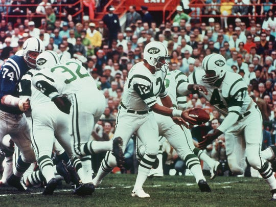 Quarterback Joe Namath of the New York Jets hands off the football to Matt Snell during Super Bowl III on Jan. 12, 1969.