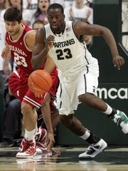 Michigan State's Draymond Green goes for the loose ball against Indiana's Bobby Capodianco on Jan. 30, 2011.