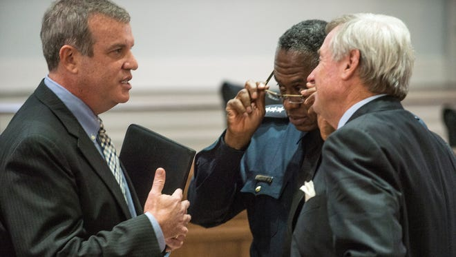 Dan Wertheimer, left, chief inspector with U.S. Marshals Service, Gulf Coast Regional Fugitive Task Force, speaks with Montgomery Police Chief Ernest Finley and Montgomery Mayor Todd Strange following an announcement Thursday, Oct. 29, 2015, of results of Operation Triple Beam - a federal, state and local effort to reduce violent crime and take illegal weapons off the streets of Montgomery.