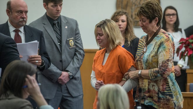 Hallee McLeod, center, is led out of Judge Glenn Goggans' courtroom by her mother Dot Faust on Thursday, Dec. 10, 2015, at the Elmore County Judicial Compex in Wetumpka. McLeod's bond was left at a total of $300,000 in a hearing in a case involving her son, who is the center of a child abuse case after he was found abuse in Bay County, Florida under the care of her boyfriend.