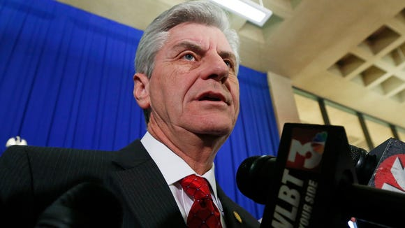 Gov. Phil Bryant talks with reporters