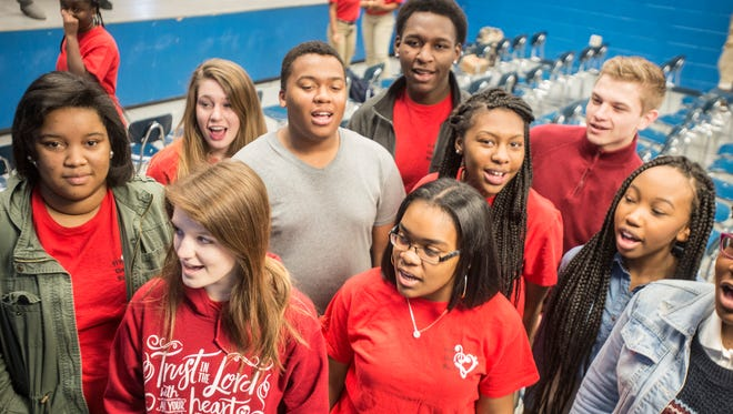 """BTW students sing a portion of the song """"I Want To Know What Love Is."""" Booker T. Washington Magnet High School's choir was announced Thursday, Feb 17, 2017, as earning the spot to perform on stage with Foreigner on Sunday at the Montgomery Performing Arts Centre."""