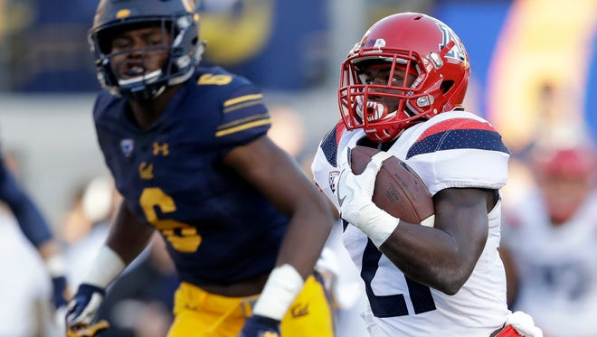 Arizona running back J.J. Taylor (21) runs for a touchdown past California safety Demetrius Flannigan-Fowles (6) during the first half of an NCAA college football game Saturday, Oct. 21, 2017, in Berkeley, Calif. (AP Photo/Marcio Jose Sanchez)