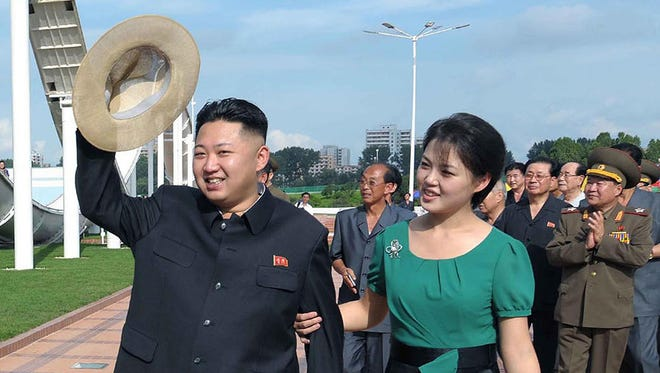 This undated picture released by North Korea's official Korean Central News Agency via the Korea News Service on July 26, 2012 shows North Korean leader Kim Jong-Un accompanied by his wife Ri Sol-Ju visiting a wading pool at the Rungna People's Pleasure Ground in Pyongyang.