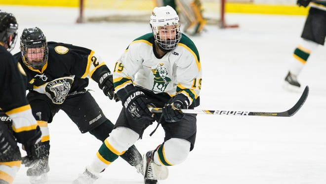 St. Norbert forward Mason Baptista handles the puck against Adrian College during a game last season at the Cornerstone Community Center.