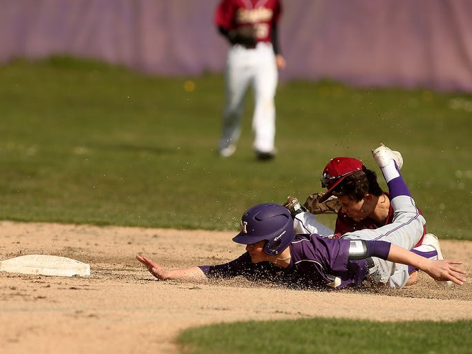 North Kitsap's Isaac Richardson gets tangled up with