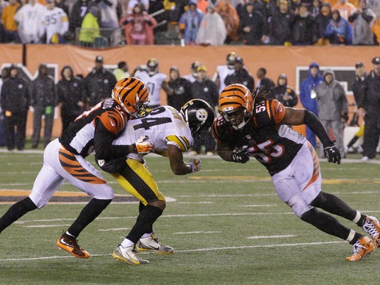 FILE - In this Jan. 10, 2016, file photo, Cincinnati Bengals' Vontaze Burfict, right, runs into Pittsburgh Steelers' Antonio Brown (84) during the second half of an NFL wild-card playoff football game in Cincinnati. The Bengals insist they're past the meltdown that cost them so dearly in a playoff loss to the Steelers last January. The two teams meet again on Sunday. (AP Photo/John Minchillo, File)