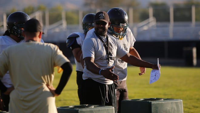 Navajo Prep coach Rod Donetso discusses defending against single-wing formations up front during Monday's practice. The Eagles have won back-to-back games, outscoring foes 104-8 the last two games.