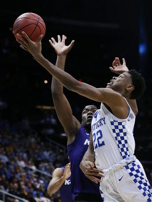 Kentucky's Shai Gilgeous-Alexander goes up against a Kansas State defender. 
