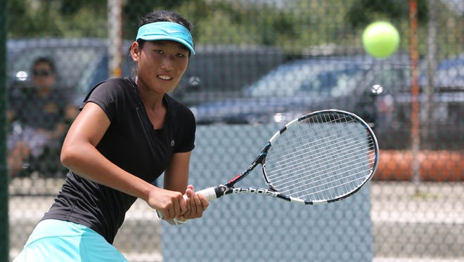 No. 6 Carol Youngsuh Lee of the Northern Mariana Islands keeps her eye on the ball as she back pedals for a backhand return against No. 1 Sara Tsukamoto of the United States in a quarterfinal match of the 2016 Chuck E. Cheese's ITF Junior Championships Girls Singles draw at the Rick Ninete Tennis Center in Hagåtña Thursday. Tsukamoto won 6-0, 6-3.