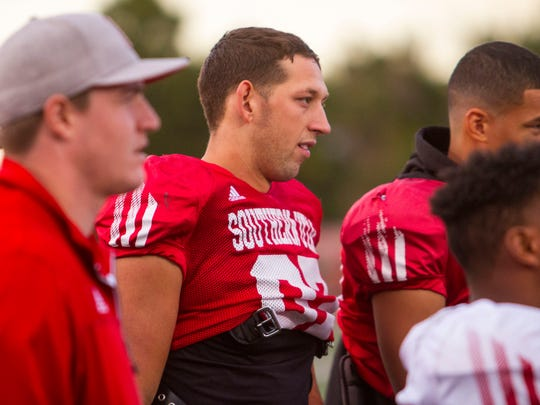 Southern Utah defensive lineman Chance Bearnson listens to his coaches at the end of practice on Wednesday, September 28, 2017.