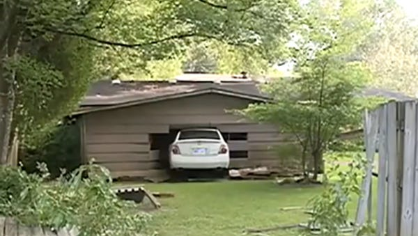 Officers were pursuing a stolen Nissan Altima Tuesday when the suspect crashed the car into the side of a garage.