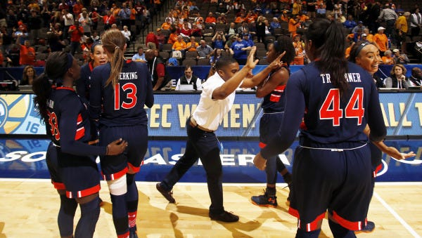 Auburn celebrates its 47-45 victory over Missouri in the second round of the Southeastern Conference Tournament Thursday.