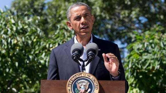 President Barack Obama makes a statement to the media from the island of Martha's Vineyard, Thursday, Aug. 15, 2013.