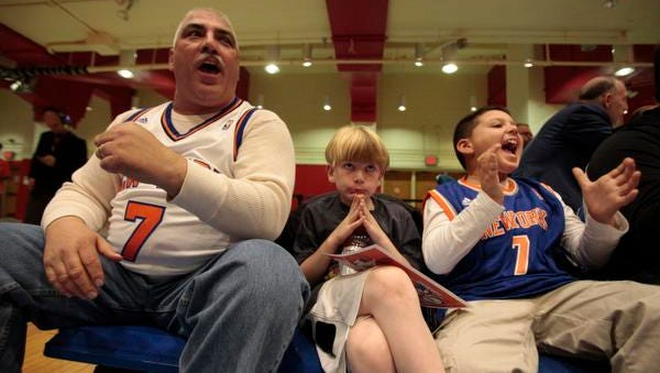 Westchester Knicks fans, from left, Robert Natale, Luke Daly and Nicholas Natale watch the first half of a preseason game against the Delaware 87ers at the County Center in White Plains on Monday night.