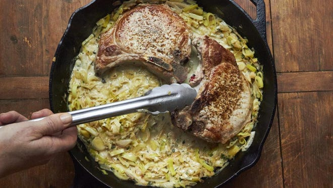 This dish of pan seared pork chops with Madeira wine and leek sauce is from a recipe by Katie Workman.