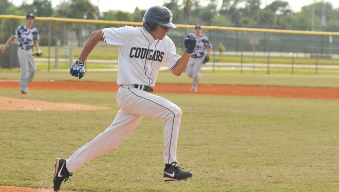 M.I.C.'s Alek Turko scores a run during a baseball game in April. The Cougars were recognized by the FHSAA for sportsmanship.