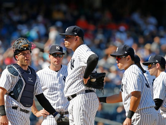 New York Yankees relief pitcher Dellin Betances, center, stands on the mound after allowing the go-ahead run in the eighth inning of a baseball game against the Toronto Blue Jays in New York, Wednesday, July 5, 2017. New York Yankees manager Joe Girardi took Betances out of the game after the run.