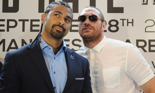 British heavyweight boxers David Haye, left, and Tyson Fury will fight on Feb. 8 in Manchester, England.