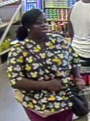 An unidentified woman sought in connection with counterfeit