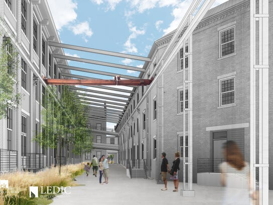 Rendering illustrates the lofts' courtyard.