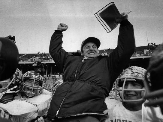 Moeller coach Steve Klonne whoops it up as he's carried