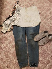 Courtney Jayne posted pictures of her clothes -- muddy
