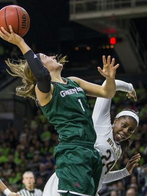 UW-Green Bay's Jen Wellnitz (1) goes up for a shot over Notre Dame' Arike Ogunbowale (24) during the second half of Notre Dame's 71-67 win on Thursday.