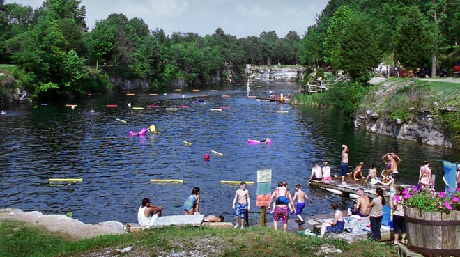 People enjoy a day at White Rock Park's main lake near St. Paul, Ind.