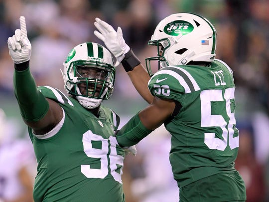 Jets defensive end Muhammad Wilkerson, left, and inside linebacker Darron Lee celebrate after a play against the Buffalo Bills Thursday in East Rutherford, N.J.