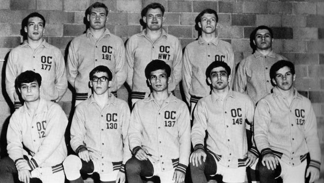 Mike Latimer (top row, left) wrestled at 177 pounds for Olympic College.
