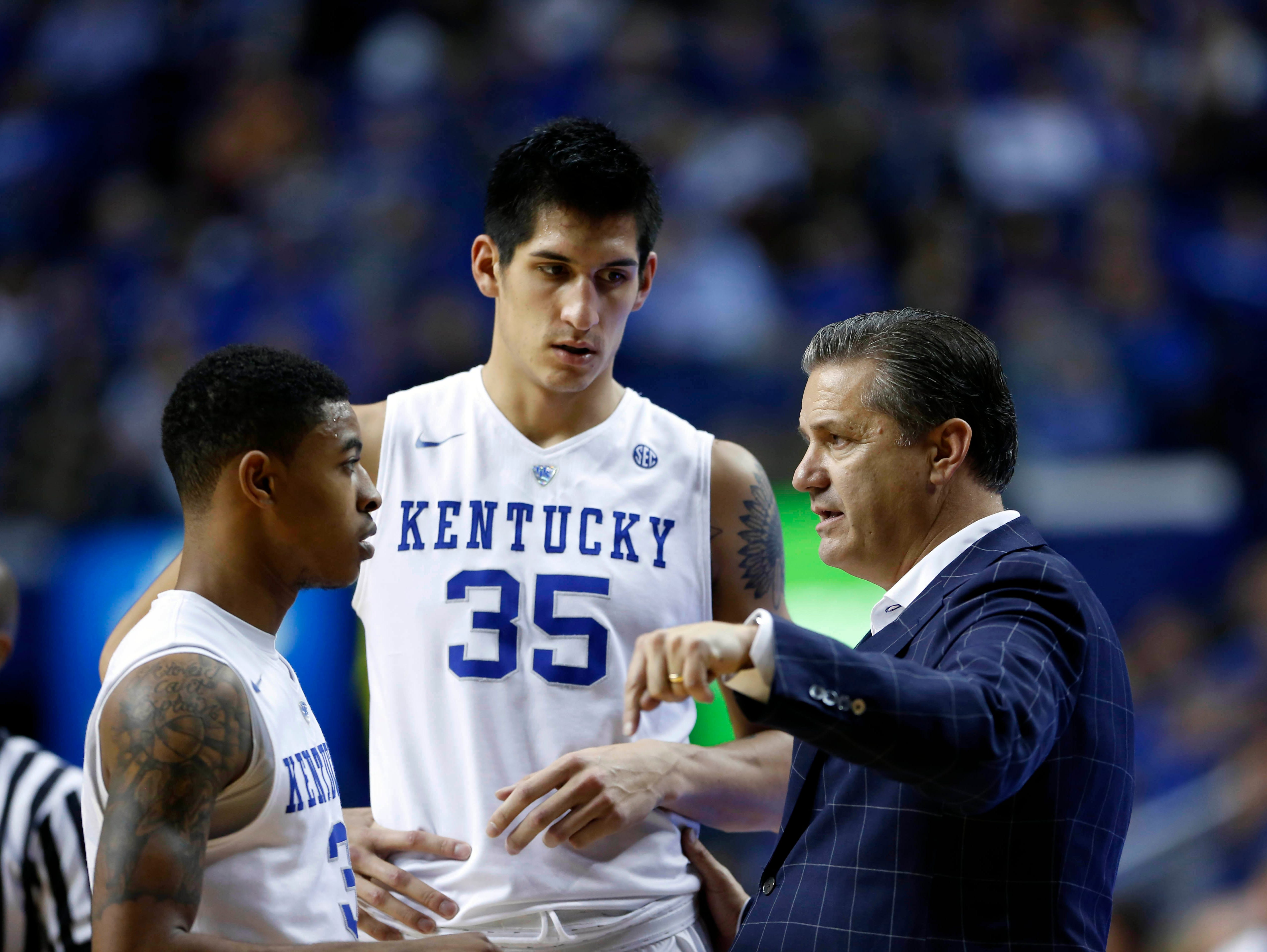 Nov 6, 2015; Lexington, KY, USA; Kentucky Wildcats head coach John Calipari talks with forward Derek Willis (35) and guard Tyler Ulis (3) during the game against the Kentucky State Thorobreds in the second half at Rupp Arena. Kentucky defeated Kentucky State 111-58.