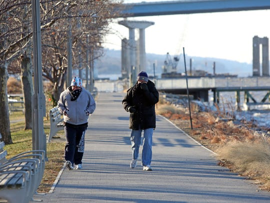 Morning walkers bundled up near the Tarrytown riverfront