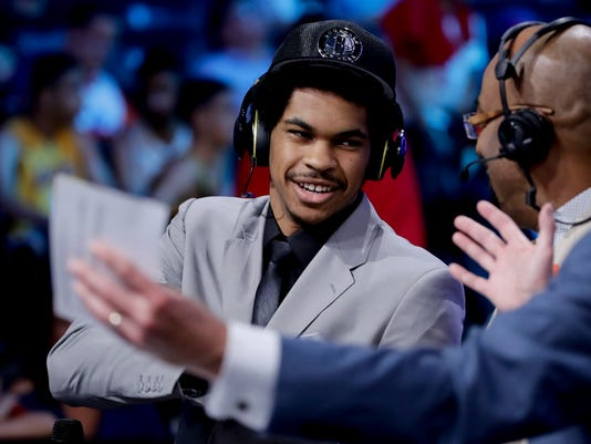 Texas center Jarrett Allen answers questions during an interview after being selected by the Brooklyn Nets as the 22nd pick overall during the NBA basketball draft, Thursday, June 22, 2017, in New York. (AP Photo/Frank Franklin II)