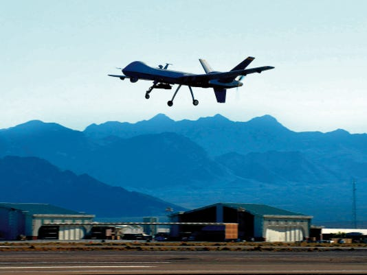 An MQ-9 Reaper performs touch-and-go flight patterns June 13, 2014, at Creech Air Force Base, Nevada. The Reaper is an armed, multi-mission, medium-altitude, long-endurance remotely piloted aircraft that is employed primarily as an intelligence-collection asset and secondarily against dynamic execution targets.