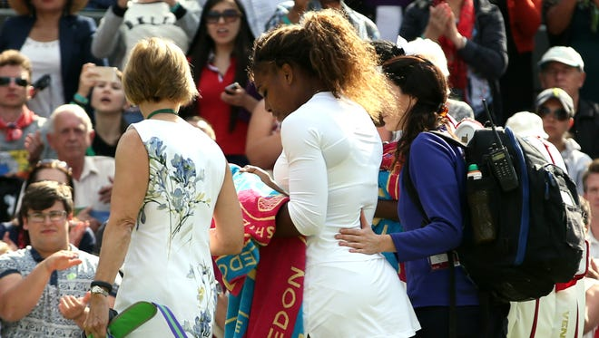 Serena Williams walks off the court after illness forces her to retire from doubles match Tuesday with sister Venus.