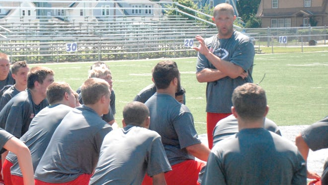 St. Joseph Central Catholic football coach TJ Buckley speaks to his team following the Crimson Streaks' 7-on-7 passing scrimmage against Monroeville last July.
