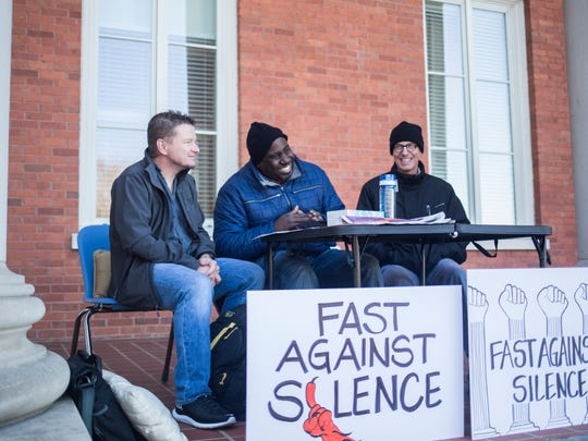 Clemson faculty members (from left) Mike Sears, Chenjerai Kumanyika and Todd May begin a public fast Monday in Clemson to protest President Donald Trump's travel ban and to press the university to speak out against the executive order.