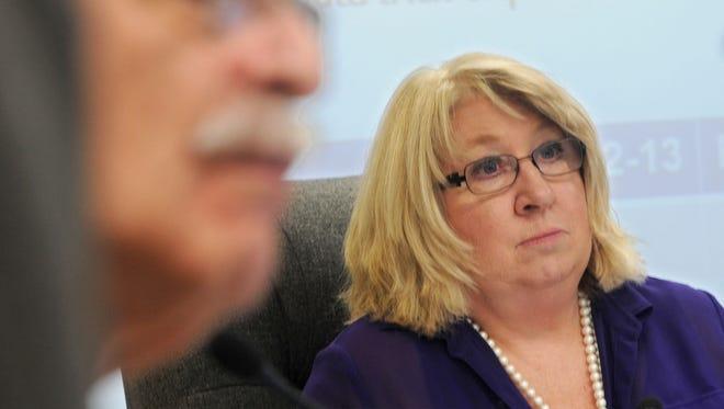 Washoe County School Board President Barbara Clark sits behind Howard Rosenberg during a board meeting on Jan. 28, 2014.