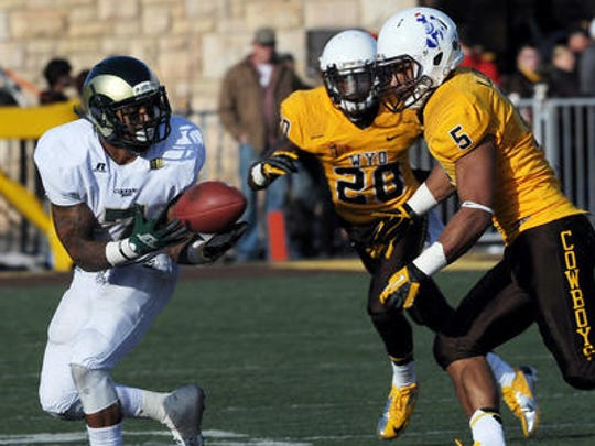 Wyoming's Korey Jones makes a play on CSU's Donnell Alexander in a game in 2012. Jones, a Fort Collins native, is currently playing for the Edmonton Eskimos of the Canadian Football League.